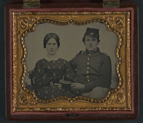 Hand-colored ambrotype of an unidentified soldier in Union uniform holding the hand of an unidentified woman, between 1861 and 1865.