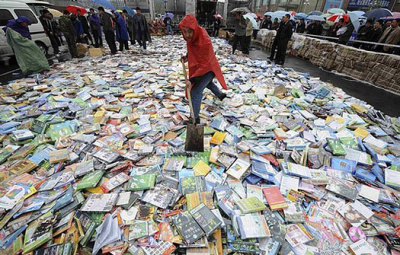 towerofsleep:  Shoveling pirated DVDs in Taiyuan, Shanxi province, China, April 20, 2008. From here. Hito Steyerl, In Defense of the Poor Image / Journal / e-flux The poor image is a copy in motion. Its quality is bad, its resolution substandard. As it accelerates, it deteriorates. It is a ghost of an image, a preview, a thumbnail, an errant idea, an itinerant image distributed for free, squeezed through slow digital connections, compressed, reproduced, ripped, remixed, as well as copied and pasted into other channels of distribution. The poor image is a rag or a rip; an AVI or a JPEG, a lumpen proletarian in the class society of appearances, ranked and valued according to its resolution. The poor image has been uploaded, downloaded, shared, reformatted, and reedited. It transforms quality into accessibility, exhibition value into cult value, films into clips, contemplation into distraction. The image is liberated from the vaults of cinemas and archives and thrust into digital uncertainty, at the expense of its own substance. The poor image tends towards abstraction: it is a visual idea in its very becoming.  The poor image is an illicit fifth-generation bastard of an original image. Its genealogy is dubious. Its filenames are deliberately misspelled. It often defies patrimony, national culture, or indeed copyright. It is passed on as a lure, a decoy, an index, or as a reminder of its former visual self. It mocks the promises of digital technology. Not only is it often degraded to the point of being just a hurried blur, one even doubts whether it could be called an image at all. Only digital technology could produce such a dilapidated image in the first place.  Poor images are the contemporary Wretched of the Screen, the debris of audiovisual production, the trash that washes up on the digital economies' shores. They testify to the violent dislocation, transferrals, and displacement of images—their acceleration and circulation within the vicious cycles of audiovisual capitalism. Poor images are dragged around the globe as commodities or their effigies, as gifts or as bounty. They spread pleasure or death threats, conspiracy theories or bootlegs, resistance or stultification. Poor images show the rare, the obvious, and the unbelievable—that is, if we can still manage to decipher it.