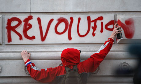 elitc:  A student protester spraypaints the word 'revolution' on a wall in London. (via the Guardian)  Tens of thousands of students walked out of class across the UK today. (more)