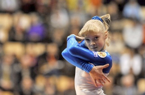 Baby Tatiana Nabieva! Brigid at the Couch Gymnast mentioned during Worlds that the Russians always seem to know where a camera is to stare down! So cute! Credit goes to whoever took the photo. PS. I love this leotard!