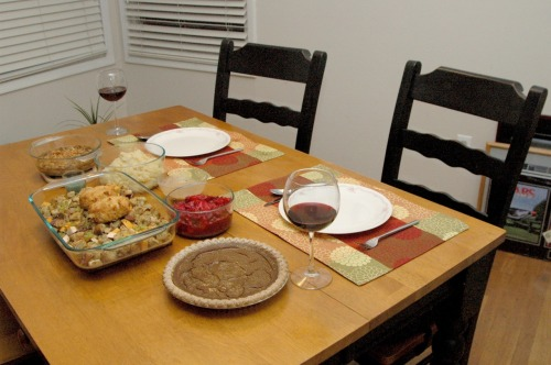 Happy Thanksgiving from reader Danya and her lovely, perfect table! Four courses, gravy, wine, dessert—honestly we don't know how she managed to wait after setting it all out to take a photo! Happy Thanksgiving, Danya!