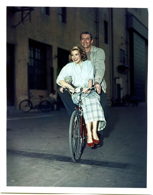 ridesabike:  Grace Kelly and Jimmy Stewart ride a bike.