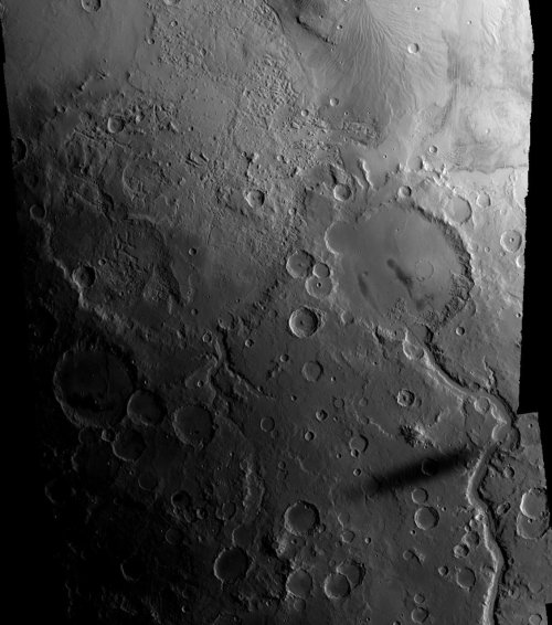 unknownskywalker:  Gusev crater and Phobos' shadow An obliquely lit Mars Express view of Gusev crater, the landing site of the Spirit rover, includes the elongated shadow of Phobos to its south. • Source: The Planetary Society Blog
