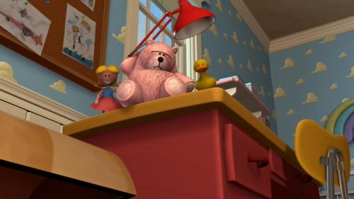 "An early version of Lotso can be seen in the first Toy Story during the staff meeting. Woody asks if the toys ""up on the shelf can hear"" him, and we see a shot of a big, pinkish bear. John Lasseter wanted to use Lotso in the original Toy Story, but PIXAR had troubles getting the fur right."