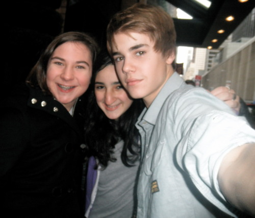 "November 26th 2010, I knew Justin was going to be in New York City, since he had his book signing. But there was NO way I could get in to meet him there, so I started to look for alternative options. My friend had told me the hotel he was going to be staying in a few days before, and I knew I had to go. Me and my friend took the train into the city, and it took a lot of convincing before I got her to walk the 12 blocks with me to the hotel. As soon as we got there, two girls said Justin had just left! I wasn't going to give up though. We waited for an hour, and then got some lunch. On the way back, I had a feeling something good was about to happen. About half an hour later, I saw Kenny get out of a big black car. I knew that was my chance. Justin followed right after. I couldn't believe I was finally about to meet him after trying to so many times. I stood up, and asked him for a picture. He was in a rush, so he asked if me and my friend could take our picture together, and then grabbed my camera out of my hand and took the picture for me! I couldn't have asked for a better picture, or a better day. When Justin says ""never say never"" he really means it. With enough perseverance, anyone can meet Justin! -Rachel"