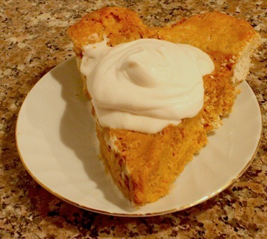 Happy Thanksgiving from reader Eileen and her pumpkin pie with a splendid dollop of whipped coconut cream topping. I've still never had whipped coconut cream—is it as good as its reputation? It looks so luscious on this piece of pie, here. Happy Thanksgiving, Eileen!