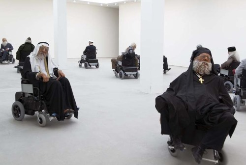 "Creepy cool sculptures. trond:  Sun Yuan & Peng Yu ""Old persons home"" 13 x life size sculptures and 13 x dynamoelectric wheel chairs Dimensions variable 2007"