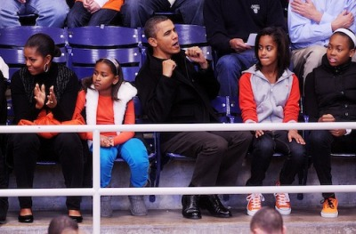 Politics As Usual: The Obamas @ Howard b-ball game…