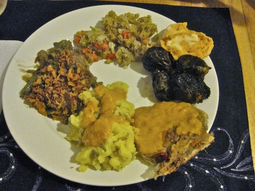 Happy Thanksgiving from reader Aimee in Maryland, who arranged on her plate, clockwise from the bottom: mashed potatoes, with butternut squash gravy by Roots Market in Clarksville; green bean and mushroom casserole from a PPK recipe; stuffing by Roots Market in Clarksville; Tal Ronnen's sweet potato biscuits; roasted brussel sprouts; and Field Roast en croute. Butternut squash gravy! As delicious as it sounds? She also turned 25 the day before Thanksgiving, so from all of us at Vegansaurus, happy birthday, Aimee! And Happy Thanksgiving, too!