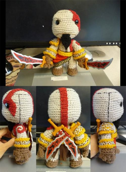 "Geekcraft of the day: Crocheted Kratos Sackboy Created by Magyss from DeviantArt, this Little Big Planet inspired piece of knittery features ""A real antique brass-colored zipper, silver-tone chain trim, crocheted thread tattoo markings, and custom sculpted and painted polymer clay swords which can be held in his hands or cross-slung over his back."" Via"