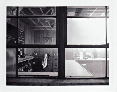 outside looking in  distanced polaroid (land camera) shot of same print shop. fuji black and white peel apart instant film FP-3000b     photography /  © 2010  debora smail l realityphotography