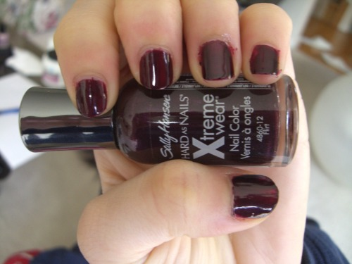Flirt by Sally Hansen Xtreme Wear Flirt is that rare creature, a vamp that I actually like. It's dark enough to be vampy, but not so much that it becomes indistinguishable from black under most lighting. This deep plum creme hits the right balance of edgy and chic, the only drawback being that it requires three coats for opacity. I used two in this picture, and you can clearly see bald spots.