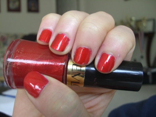 Frankly Scarlet by Revlon Frankly Scarlet is one of the few Revlon colors worth giving a damn about. This brilliant tomato red reminds me of a lot of Zoya's duochromes because it's got the same smattering of gold glitter. Unlike many Revlons, Frankly Scarlet applied beautifully—I suspect because I got an older bottle, and time has allowed the normally watery Revlon formula to thicken to the consistency I prefer. I never thought I'd compare nail polish to wine, but age has definitely allowed Frankly Scarlet to come into its own, like a bottle of Cabernet Sauvignon. Interestingly enough, this means that Revlons have a different life cycle than most other polishes, which tend to get less usable over time. Lest readers think this phenomenon is an anomaly, I got my hands on another older Revlon which also applied very well, review coming soon!