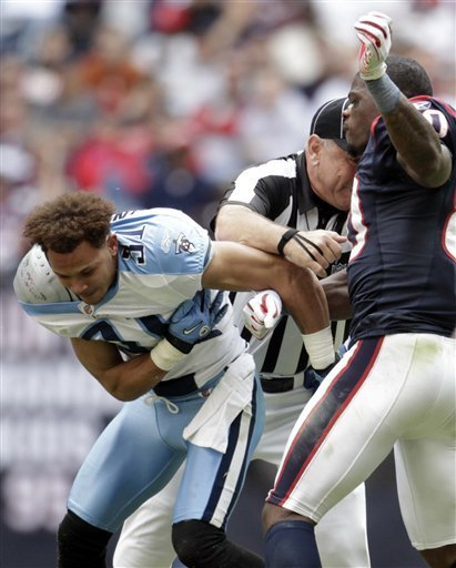 Cortland Finnegan has only been asking for it for 4 years. Andre Johnson (with a 5 inch 40lb advantage) has had enough of the self professed dirtiest player in the NFL. He landed a few hay-makers before being ejected earlier today.