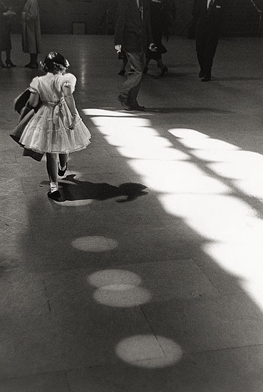 "Louis Stettner © Louis Stettner ""Girl Dancing in Circles, Penn Station 1958"""