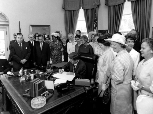 President John F. Kennedy signs the Equal Pay Act on June 10th, 1963.