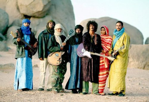 For members of the renowned Malian group Tinariwen, male members have often been traditionally more covered up than the female members.