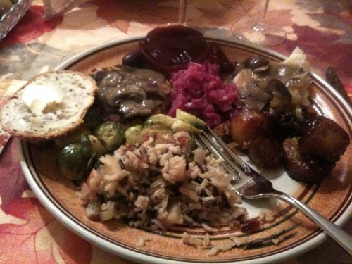 Happy Thanksgiving from reader Megan M.! On her plate you can see bread with Earth Balance, Thanksgiving cutlets, fancy olives, two kinds of cranberry sauce, German-style red cabbage, mashed potatoes with mushroom gravy, brandied yams, apple-sage wild rice, and roasted brussels sprouts. She says that it was an all vegan Thanksgiving attended by three vegans and six omnivores, all of whom were very pleased with the dinner. Happy Thanksgiving, Megan!