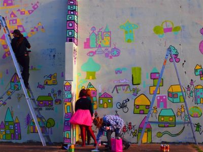 street artist tom civil and friends painting a mural in armidale, new south wales, australia.  lots of little aqua and pink and yellow houses with stick figures running in between.  these are my favourite colours at the moment.  it's funny, all through winter I pretty much only wore black and charcoal and red.  I never realised how much the weather affects my taste.