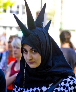 An unidentified Muslim woman wears the traditional hijabi spikes of her people.