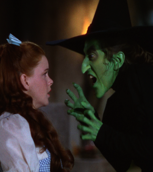 "Margaret Hamilton & Judy Garland in The Wizard of Oz (1939, dir. Victor Fleming) ""I suppose I've turned down a fortune [by  refusing countless offers to  re-create the  role], but I just don't want  to spoil the magic. Little  children's minds can't cope with seeing a  mean witch alive again. Many  times, I  see mothers and little children and the mothers always  recognize me as  the witch. Often, they say to the kids, 'Don't you know  who she is?  She's the witch in The Wizard of Oz! Then the kids look  worried and say, 'But I thought she melted.' It's as though they think  maybe I'm  going to go back and cause trouble for Dorothy again."" -Margaret Hamilton, The Washington Post (1973)"