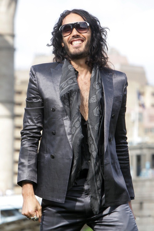 Russell Brand is crazy attractive (emphasis on the crazy) with his dark and dirty beard.  That beard, paired with that hairy chest and greasy, untamed lion's mane, makes him look like he reeks of cigarettes and stale beer.  I'd hit it, shower, then hit it again. Beard lovers everywhere, however, were devastated to discover Brand had done away with his beard for the Arthur remake.  We wait with bated breath for the return of that Spectacular Beard because, much like Samson, he loses all power (to turn us on) when he has no hair.  Not that he's not generally intelligent, funny, and adorable, obvs. (photo: Getty) —written by Mariana