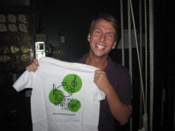 Hey 30 Rock fans — It's Kenneth, holding the Traveling T-Shirt!  This photo was taken backstage at the second of three Vampire Weekend shows at Radio City Music Hall in September 2010.  We love it when our work melds perfectly into one Kodak moment—Both NBC Universal and Vampire Weekend are supporters of Rock and Wrap It Up! Congratulations to the band on their Grammy nomination for the album Contra, announced yesterday evening.  Head here to check out more photos of people holding the Traveling T-Shirt.  You might spot a few familiar faces… Photo credit:  Ashley Hillis, Rock and Wrap It Up! Media Director