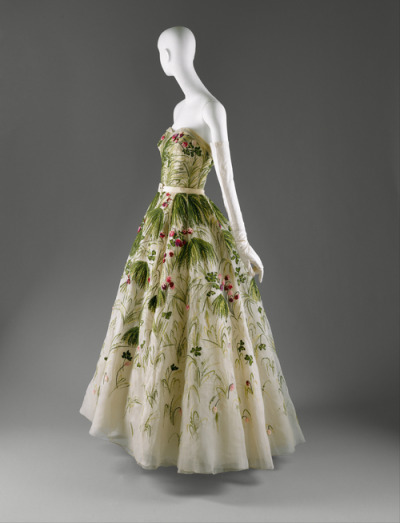 "omgthatdress:  Christian Dior ""May"" dress ca. 1953 via The Costume Institute of The Metropolitan Museum of Art ""In ""May,"" flowering grasses and wild clover are rendered in silk floss on organza. This ""simple"" patterning of meadow-gone-to-weed is composed of the tiniest French knots and the meticulously measured stitches of the hand embroiderer, suggesting that for Dior, it was not only that beauty resides in the most rustic, but also that the most successful artifice is a beguiling naivété."""