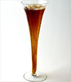 Black Velvet, if you please. 1/2 Guinness, 1/2 bubbly. Picture from NYT Food and Drink.