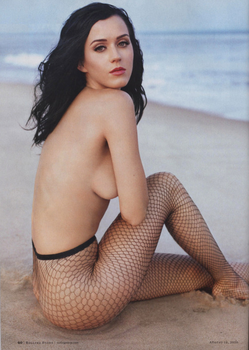 Oh look, it's natural beauty Katy Perry! Just soul searching, you know? Demurely cradling her sideboob, sitting on the sand in her favorite pair of fishnet stockings, watching the waves crash by.