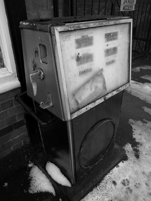 1950s-60s petrol pump & snow.