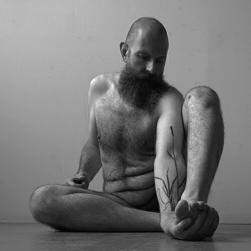 i'm grumpy. here's a (self-portrait?) photo of a naked bearded man that is beautiful and distracts me from my grumpiness.