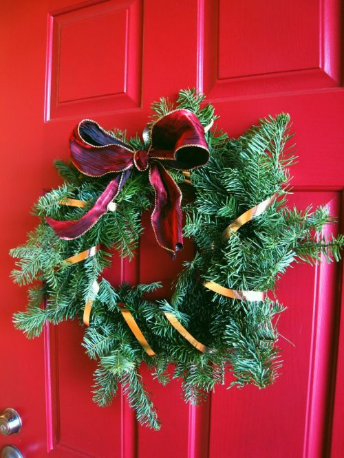 This was the DIY wreath I made last year with some fresh tree branches, a wire hanger and ribbon. I love it because it's the first wreath I made myself, but it's sort of traditional. I think I'll try to do something a little more fun this year.