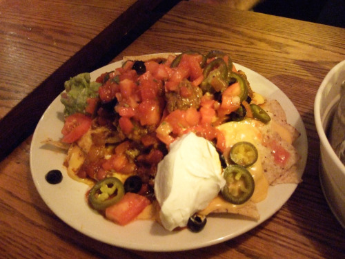 "Sidetrack Macho Nachos, 12/5/10 Apologies for the lack of process photos, but we were danged hungry.  The macho nachos were top-loaded, making them difficult to distribute, but otherwise holy wow were these great nachos.  Heavy on the guilt factor - that couldn't have been anything other than processed cheese ""food"" - but an excellent amount and variety of stuff, good chips, good salsa, and the combination of cheese and beef was sort of like queso - a bonus!"