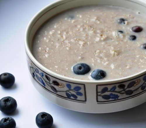 Blueberry Oatmeal Ingredients: 1/2 cup of Quaker Oats 1/2 cup of skim Milk (or soy milk) 1/2 cup blueberries 1/2 cup water 1/8 teaspoon cinnamon 1 tablespoon maple syrup Method: 1)Add oats to a small pot on medium heat. Mix in milk and water. 2) Stir and wait 3 to 5 minutes until the mixture thickens. 3) In the meantime, measure and set aside your blueberries.   4) Check on the oatmeal, and lower heat to dial #2 (low heat). 5) Add cinnamon, pure vanilla, maple syrup, and fresh blueberries. 6) Stir and allow this to cook for 3 to 5 minutes.  Try to pop the blueberries… this will release all the blueberry goodness and the color. 7) Serve hot.  Ain't it good? Oats help reduce cholesterol and are a good source of Protein and Fiber. Blueberries are a very good source of Vitamin C and Fiber.  They are a good source of Vitamin E. In addition, blueberries are an Antioxidant powerhouse.  Milk is a very good source of Calcium and Vitamin D. It is also a good source of Protein, Vitamins A and K. What could be better for breakfast? This makes a delicious pot with 291 calories if using milk and 315 if made vegan with soy milk.