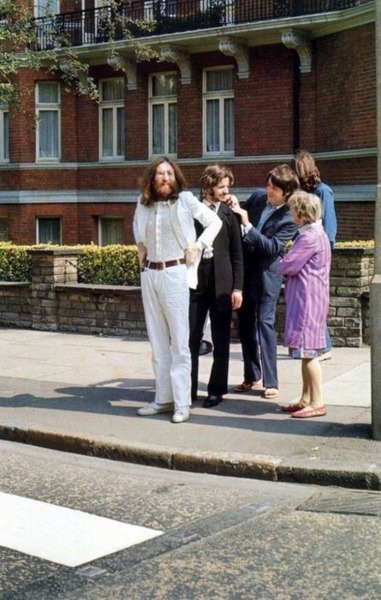 gottahavethesparkly:  The Beatles Mere Seconds Before the Iconic Abbey Road Photo