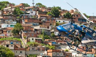 "Rio de Janeiro favelas to get facelift as Brazil invests billions in redesign | World news | The Guardian With the 2014 World Cup and 2016 Olympics on the horizon, authorities are engaging in two simultaneous battles to improve life in the favelas: implementing ""pioneering"" pacification schemes in the slums and splashing out billions of dollars remodelling the favelas as part of an urbanisation initiative called Morar Carioca (roughly ""Rio Living"")."