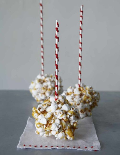 "Yummyness from Sweet Paul I love seeing all of the fun holiday recipes that come out at this time of year. Isnt this so cute? Caramel Popcorn Balls Easy to make and really fun to serve as an ""upside-down lollipop.""Makes 10 1 large bag of popcorn1 cup sugar Place the popcorn in a large bowl.Melt the sugar in a medium pan over medium-high heat.Stir once in a while so the sugar does not burn.Once melted, pour the caramel over the popcorn.Using clean rubber gloves form the popcorn into balls.(It will be hot so don't let the kids do this.)Store in an airtight container TIPS! You have to work fast because the sugar hardens really fast and wear gloves.Its very hot. A cute way to serve these is to make a handle using a lollipop stick. Hot glue rick rack ribbon. Glue to the popcorn ball with some melted sugar.Photo by Ellen Silverman"