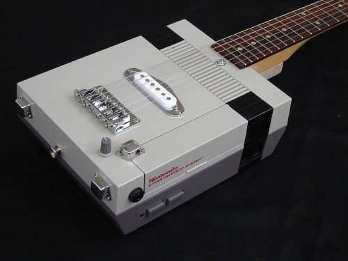 ipreferfacebook:  gamefreaksnz:  NES Electric Guitar Custom 6 String Electric Guitar with an NES body. Features a standard neck with a hard-tail bridge. Single coil pickup with volume control and an output jack. (Note: Each guitar will be slightly different with constant improvements to the design)Available Qty: 1Price: $150 [via: EPICponyz]  WIN!!!!