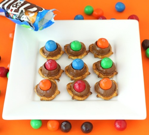 Rolo Pretzels with Pretzel M&M's Ingredients: Mini Pretzels Rolo Candies Pretzel M&M's Method: Preheat the oven to 350 degrees F. Place mini pretzels on a large baking sheet. Top each pretzel with one Rolo candy. Place in the oven for 4-5 minutes, until Rolo candies start to melt. Don't melt them all the way. Remove from oven and lightly press a Pretzel M&M on top of each Rolo. Eat warm or let them cool if you want them to set up.