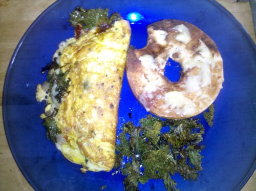 MEAL omelet (mozzarella/olive oil/kale/onion/garlic) half poppy bagel/melted brie roasted kale