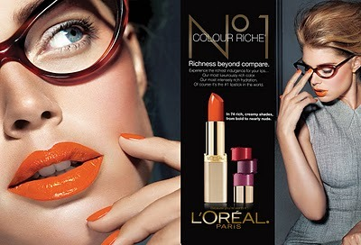 miamimami:  Doutzen Kroes for L'oreal Paris' Colour Riche Ad campaign. I've been wanting an orange lip color and nail polish just like the ones seen here.  I like the orange. And Doutzen is so cute!