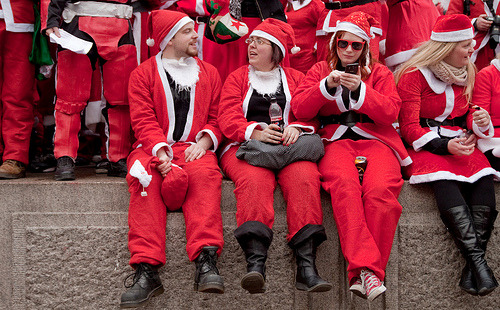London's annual Santacon hits Trafalgar Square for a carol concert and to bemuse the tourists