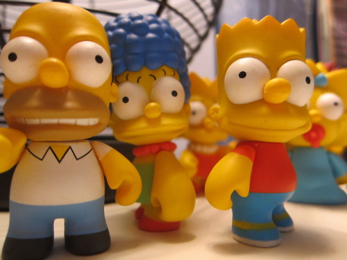 The Simpsons. Homer, Marge, Bart, Maggie and Lisa from the first wave of the Kid Robot Blind box Simpson series.