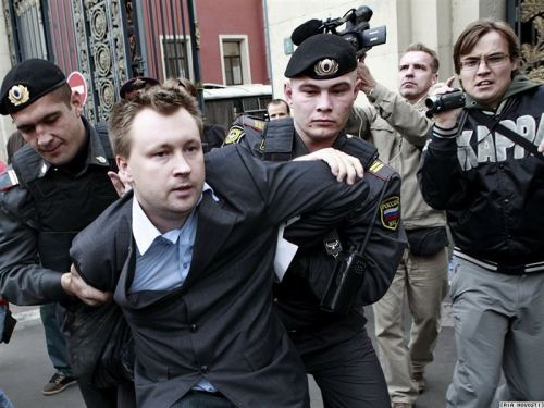 "A queer rights activist protesting Moscow mayor Yury Luzhkov's homophobia (he's called homosexuality ""satanic"") is arrested."