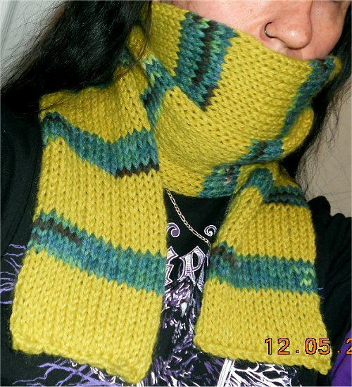 I forgot to post that I finished the Kaa Forever scarf, about a week ago. Here's a pic.