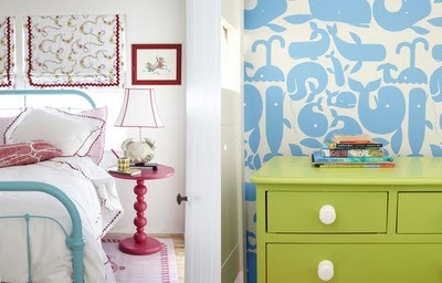 Love the color on both the dresser and that little table.