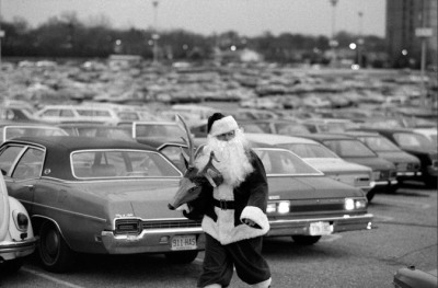 North Pole Noir - Santa at the Garden State Plaza Mall in Paramus, N.J. 1977, via the New York Times photo archive, featuring this and other non-traditional portrayals of St. Nick.