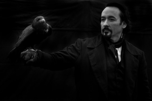 popculturebrain:  First official photo of John Cusack as Edgar Allan Poe | ONTD I'm not buying it. And you can't even see the sneakers in this one.