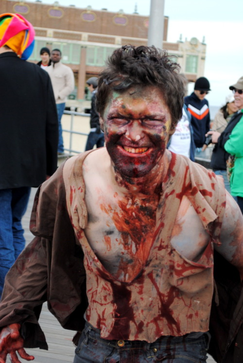 "banjoephoto:  This guy ran around all day scaring the crap out of everybody. They never expected it. Take at the Asbury Park Zombie Walk. Title: Undead Dude """"Part of the ""Undead Series""::"